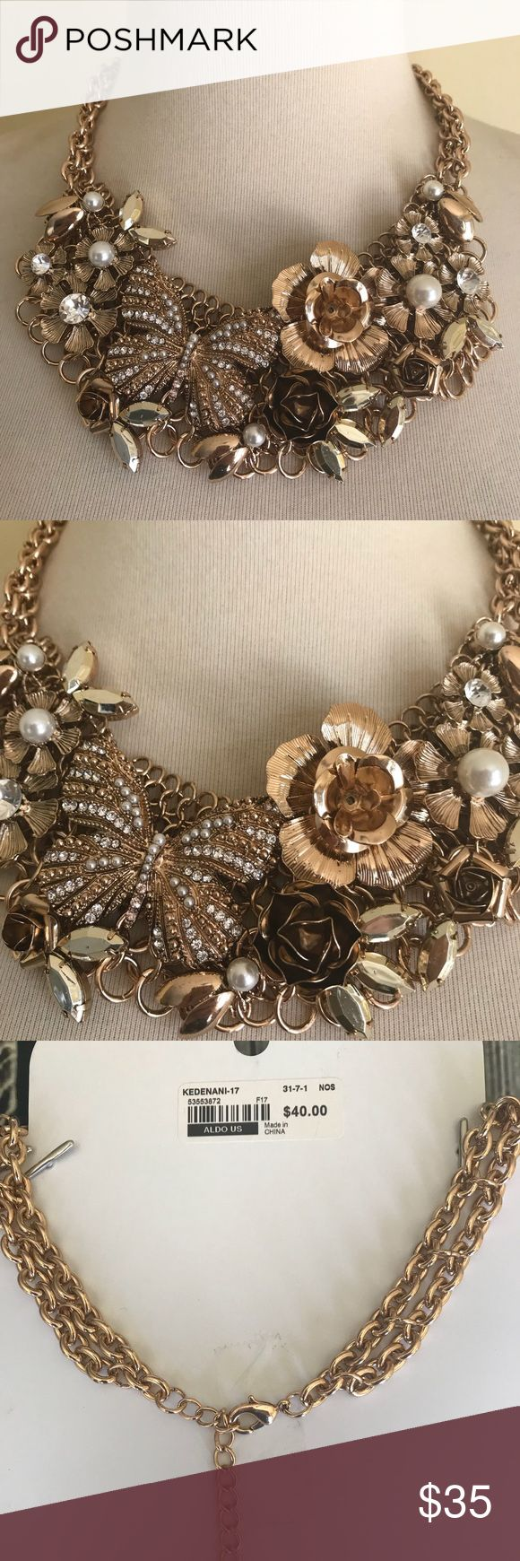 🦋Aldo Statement Necklace Bib Floral Butterfly🦋 Aldo Statement Necklace. Bib . Gold tone. New with Tags. Adjustable lobster clasp closure . Floral and butterfly theme . Aldo Jewelry Necklaces