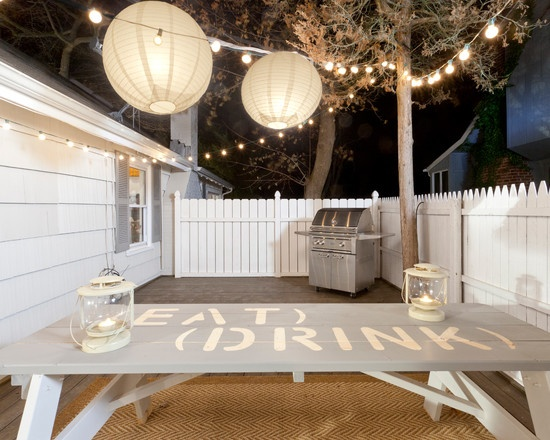 Backyard Entertaining... Lovin the lights and this just gave me a great idea to paint our fence white!