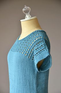 FREE Knitting Pattern → This warm-weather tee is the perfect addition to your summer wardrobe. It is intended to be worn with approximately 4 to 6 inches of positive ease. The tee is knit in pieces from the bottom up. After seaming stitches are picked up along the armholes and neckline to create a neat, ribbed edge.