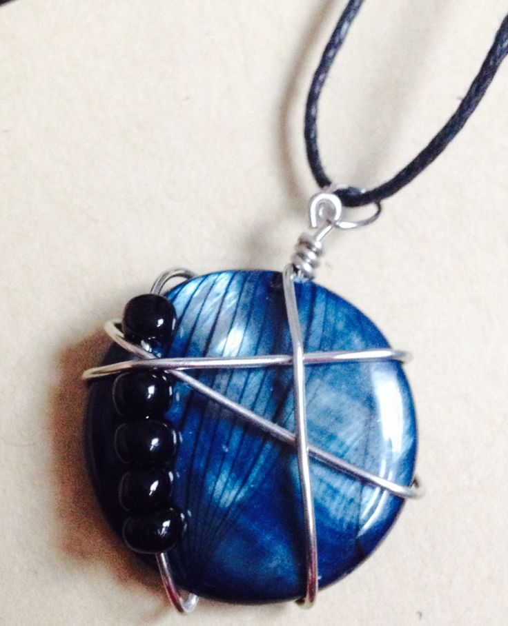 You cannot be shaken!  Beautiful blue bead mounted with wire and black seed beads. $15. Visit www.sozojewellerydesigns.com