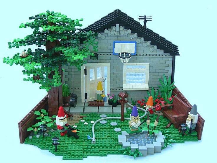 """LEGO scene from Gnomeo and Juliet. hilarious!!!! called """"lumley crosses the threshold.""""   grey lego house, gnomes, backyard scene, giant lego tree."""