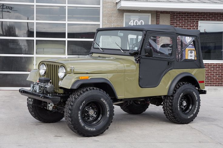 "1973 Jeep CJ5. This 1973 Jeep CJ5 has a 4.0 Liter Inline 6 Cylinder w/ Weber Carb, 4 Speed Manual Transmission, Dana 30 Rear w/ 4.10:1 Ratio, Dana 44 Front Axle, Power Steering, Disc Brakes, Clifford Intake, Stainless Headers, New Vinyl Top & Doors From Bestop, Procomp Bumpers,12,000 LB Electric Winch, Power Coated Roll Bar & Windshield Frame, SW Gauges, 15"" Powder Coated Steel Wheels, Hercules Trail Digger Tires, New Drab Green Paint, Undercoated Floors, Beautifully Restored CJ5 w/ Tasteful…"