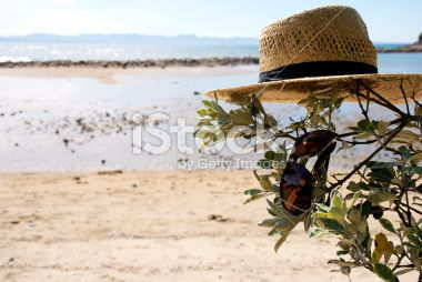 Straw Hat & Sunglass with Seascape Royalty Free Stock Photo
