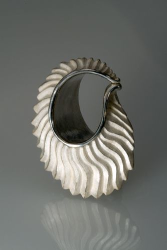 """Terry Kovalcik Jewelry - """"Shell"""", a hand-carved bead"""