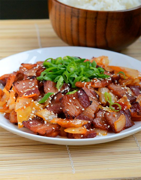 Pork Belly and Kimchi Stir-fry Serves 4 12 ounces pork belly or thickly-cut bacon 1 tablespoon peanut or vegetable oil 1 medium onion, diced 2 cloves garlic, minced 1 scallion, white and green parts separated and thinly sliced 1/3 cup kimchi 1 tablespoon soy sauce 1 tablespoon Chinese rice wine or dry sherry 2 teaspoons sesame oil 1 teaspoon chili sauce 1 teaspoon white sesame seeds