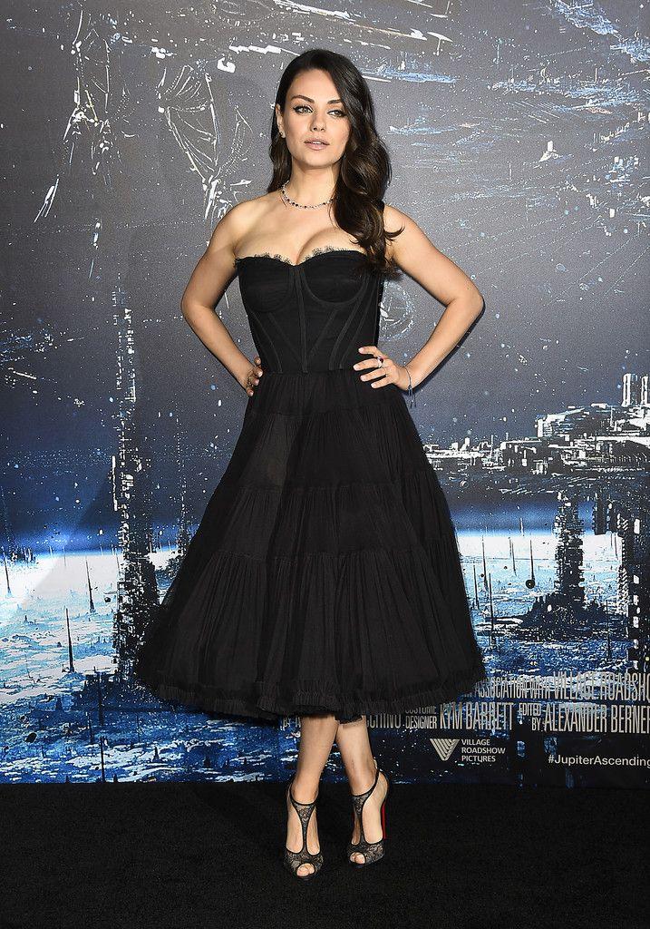 Mila Kunis.. Dolce & Gabbana Spring 2015 dress, Christian Louboutin Tiny Pumps, and Gemfields jewels..