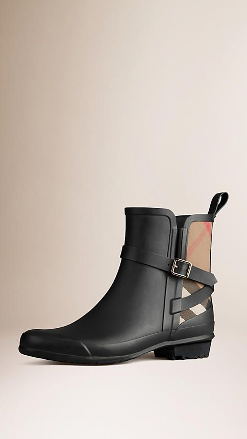 Burberry Practical matte-finish rain boots with a House check cotton panel Wrapped strap with buckle detail Inverted pleat and pull tab Rubber grip sole. Discover the shoes at Burberry.com