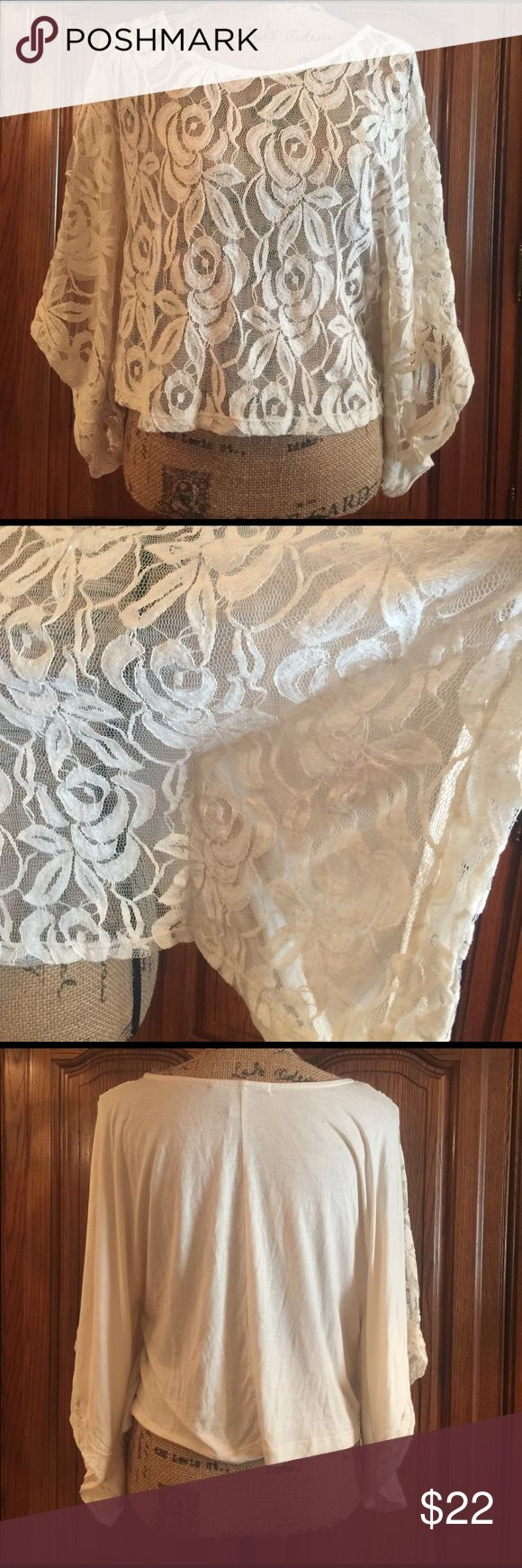 """American Rag Lace Batwing Top EUC in a pretty cream. No snags holes nor tears. It is a size medium but could fit a smaller large. It is made of 60% cotton and 40% nylon. The Lace is 100% polyester it would be great as a cover up or with a Camisole under it as the front is see through. It measures approximately 18"""" underarm to underarm and measures approximately 19"""" long measured from shoulder to hem. This is a crop style American Rag Tops Crop Tops"""