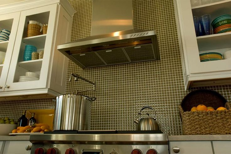 The business end of the kitchen is a professional-grade gas range with stainless-steel finish. The stove is topped with a matching stainless-steel range hood, and a pot filler faucet extends out from the back wall, making it easy to put some water on to boil and cook up some fresh shrimp or lobster. Other appliances include a large microwave mounted below the counter and a stainless-steel dishwasher.
