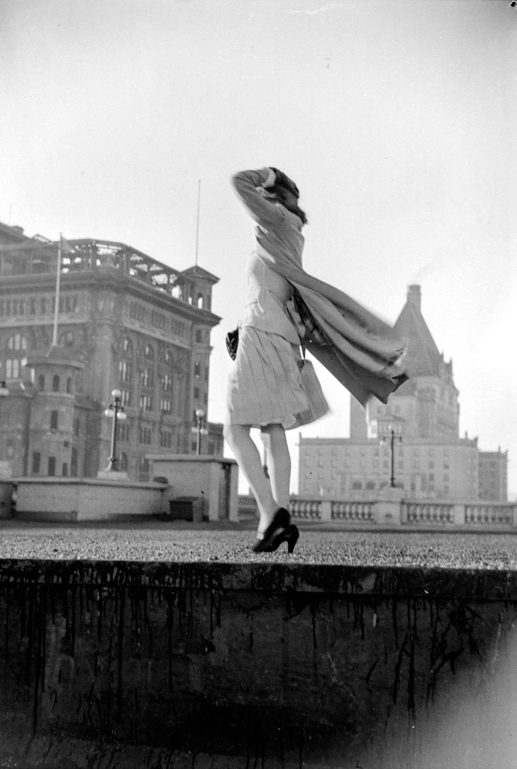 1942: The Sun's fashion editor Marie Moreau atop the Hudson's Bay, with the 2nd and 3rd Hotel Vancouver behind her. IMG by Jack Lindsay, courtesy of pasttensevancouver.tumblr.com