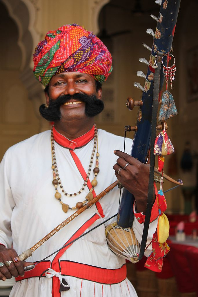 The colorful musician - Bhopa ji - playing on the Instrument [Ravanhatta] with such a happy smile on his face in Jaipur, Rajasthan, India
