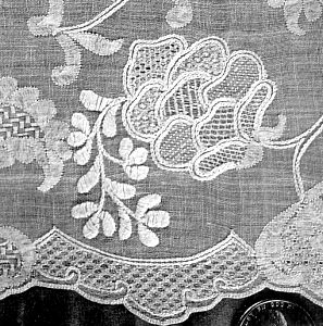 """Dresden whitework aka Schwalm. """"Combines a number of embroidery techniques including satin stitch, tambour (chain stitich),and pulled stitches to create a lace-like surface.   If done on netting it would resemble Limerick Lace"""""""
