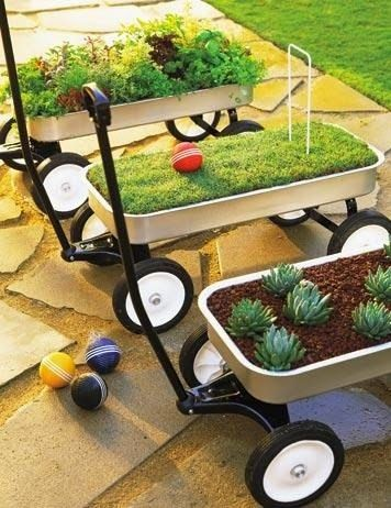These cute wagon planters could be easily moved for watering or to avoid too much sun!