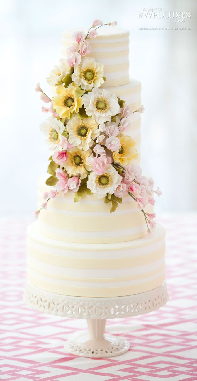 Yellow striped cake with floral accents. Bobbette & Belle