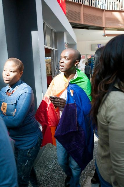 IDAHOT 2013, Johannesburg. Everyone rushing from Iranti-Org's offices to Carlton Centre for the flashmob.