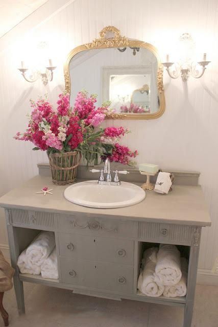 Colourful flowers in Neutral bathroom