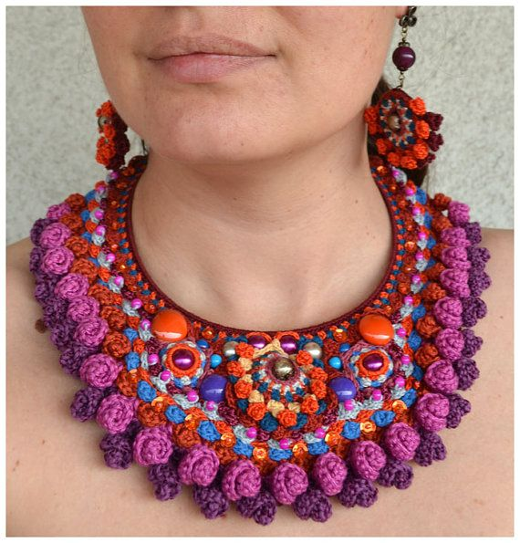 Uniquely crochet, this is a show stopper fiber necklace. Statement free form crochet necklace in colorful cotton and viscose. It incorporates glass