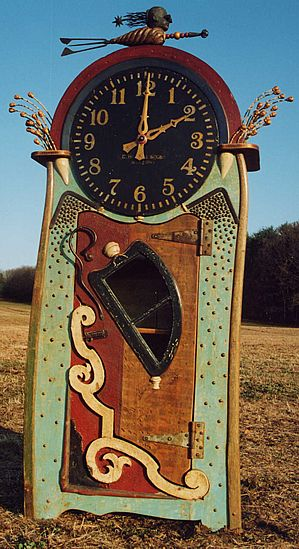 """""""Northern Exposure"""" Grand Time Piece / Armoire Sculpted from period New England artifacts: 30"""" Howard Dial Victorian house fragments 1800's Iron hardware & fittings Clock movement (new) 110V geared 9'6"""" tall x 24"""" deep x 52"""" wide"""