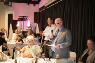 Proud Grandparents giving a speech.  Tailrace Centre, Tamar Room