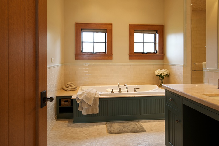 Bath with Pinnacle clad casement, awning, direct set, and swinging patio doors by Windsor Windows & Doors. www.windsorwindows.com