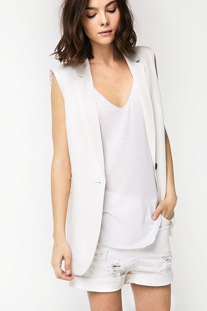 The vest is another no-brainer way to transform your existing office attire. Layer this one over a short-sleeve blouse or sleeveless shirt, team with a full skirt and heels (we're not sure how much HR will go for those shredded cutoffs...), and you've got one heck of an outfit — no sweat.   Mango