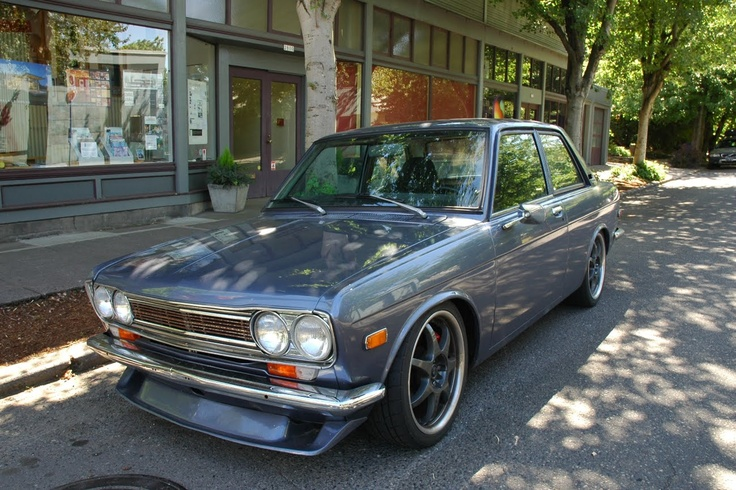 Old Parked Cars.: 1973 Datsun 510.