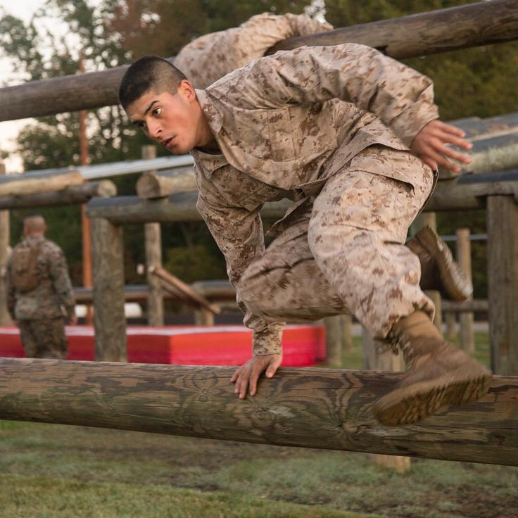 Get a Leg Up . A Marine Corps Officer Candidate attending Officer Candidate School hurdles over a log while running through the obstacle course at Marine Corps Base Quantico Virginia October 18 2017. (U.S. Marine Corps photo by Lance Cpl. Tyler Pender) . #Marines #MarineLife #USMC #OCourse #ObstacleCourse #Rah #Yut #Kill #Moto #Motivation #USMarines