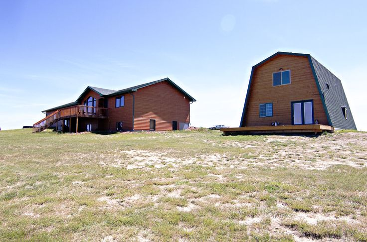 Gillette, WY home for sale! 4 bd, 3.5 ba, 3424 sqft, 5+ acres. Custom home. Entertainers basement. Shop with living quarters. Call Team Properties Group for your showing 307.685.8177