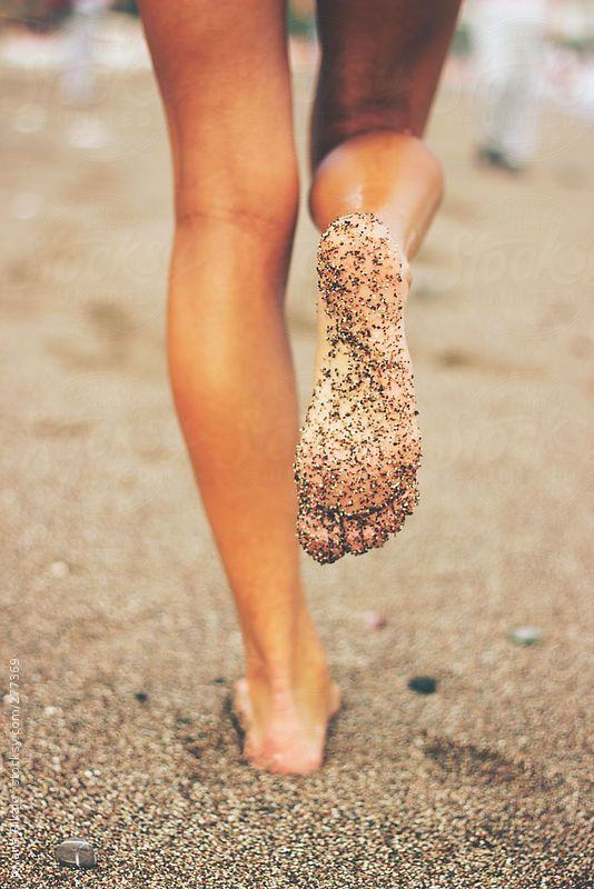 Female feet on the beach covered in sand by jovanarikalo | Stocksy United