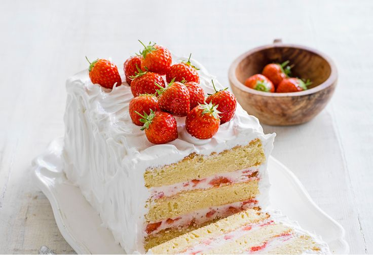 The best strawberry layer cake! This dinner-party dessert recipe is made with vanilla sponge, filled with strawberry mascarpone and covered in Italian meringue.