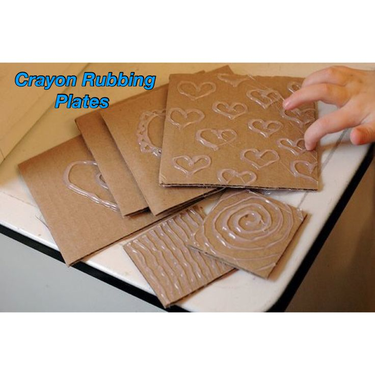 Designs with glue on cardboard to lay paper on for crayon rubbing. Cool!!