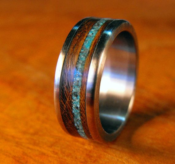 Love their work - so unique.  Titanium Ring with Wenge Wood and Turquoise Inlay