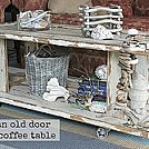 Use old doors to DIY a rustic and eclectic coffee table. :: Hometalk