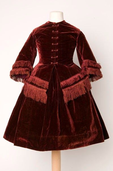 Girl's velvet suit England, Great Britain (made) Date: 1855-1860 (made) Artist/Maker: Unknown (production) Materials and Techniques: Velvet with fringe Credit Line: Given by Miss Passmore Museum number: T.138&A-1961