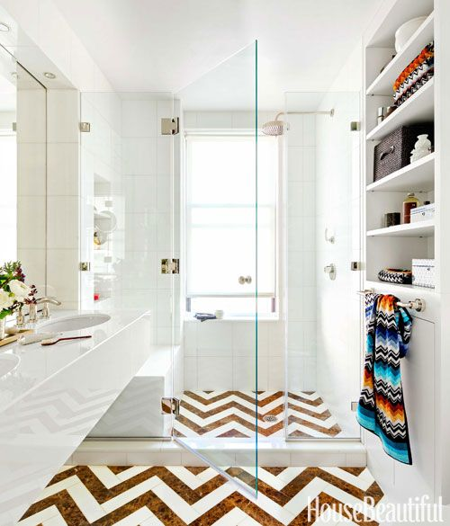 Continue floor tile into the shower to make a small bathroom feel bigger.