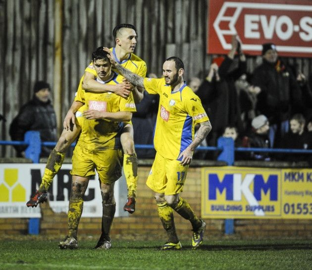 Action from King's Lynn Town v Ilkeston at The Walks - Rob Duffy celebrates his penatly to make it 3-1. Picture: Matthew Usher.