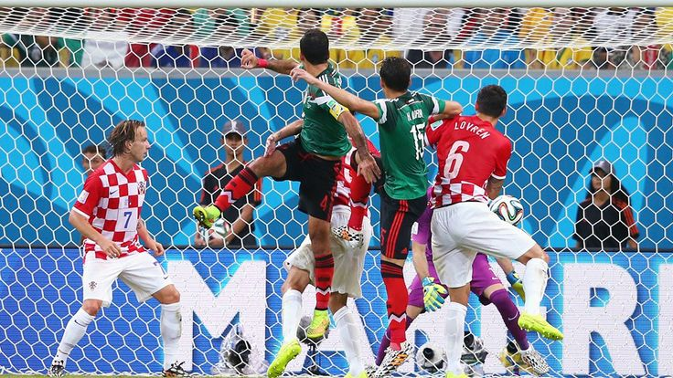 Rafael Marquez (2nd L) of Mexico scores his team's first goal during the 2014 FIFA World Cup Brazil Group A
