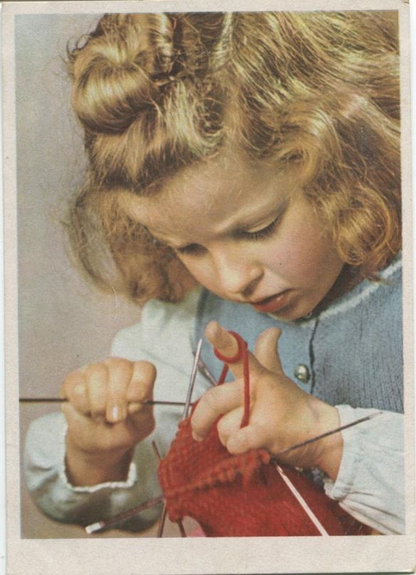 small girl knitting