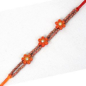 This Rakhi available on Giftblooms.com contains pretty little beads and three red plastic flowe Your brother in India will be delighted to receive this Rakhi thread along with your other gifts. The color of the thread is red and orange. Sending Rakhi to India via our website is extremely easy.