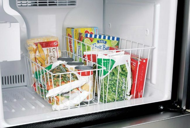 I like this idea for our travel trailer fridge.  I think keeping vegetables in one basket and meats in the other should help keep everything organized while still leaving room for ice trays and bin.  Maybe a basket a little taller would maximize space.