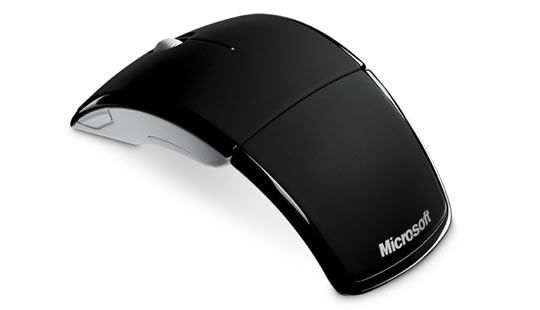 My MSFT Arc Mouse. Small package, always ready for on the go mousing. It fits into a small pouch on my backpack and I can scroll on the road.