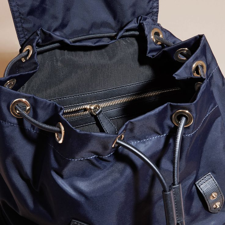 A lightweight showerproof Burberry rucksack with cushioned and polished metal chain shoulder straps and leather trims