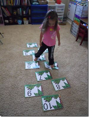 COUNTING | We play number hopscotch by laying out large number cards on the floor. Sometimes we do them in order, sometimes out of order and I'll just call a number and have her hop to it.
