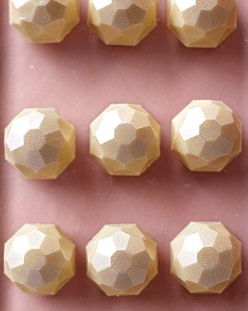 multifaceted chocolate nuggets - white-chocolate zabagilione bonbons brushed with gold luster dust, christopher norman chocolates