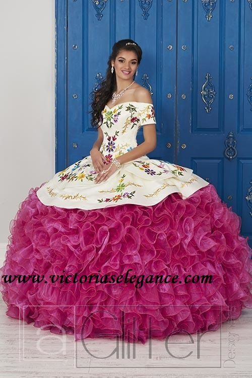 83508ddcb22 Make a bold statement in his gorgeous off the shoulder ball gown. The  bodice is accented with corset boning and beautifully decorated with  multi-colored ...