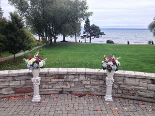 Colourful Lakefront Ceremony Flowers