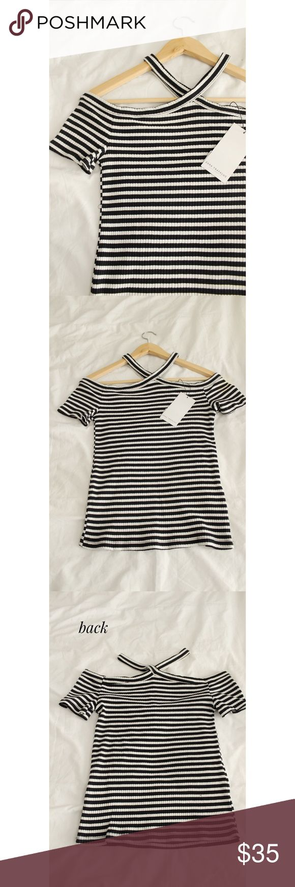Zara 2017-2018 winter collection Ribbed knit top Zara Ribbed knit top off the shoulder  Adorable Zara Ribbed knit halter style top. Black and white striped. Crossed strap collar. From the 2017-2018 winter collection Brand NEW with Tag!  Size: Small (fits Medium perfectly too)  😊 PRICE FIRM 😊 Zara Tops