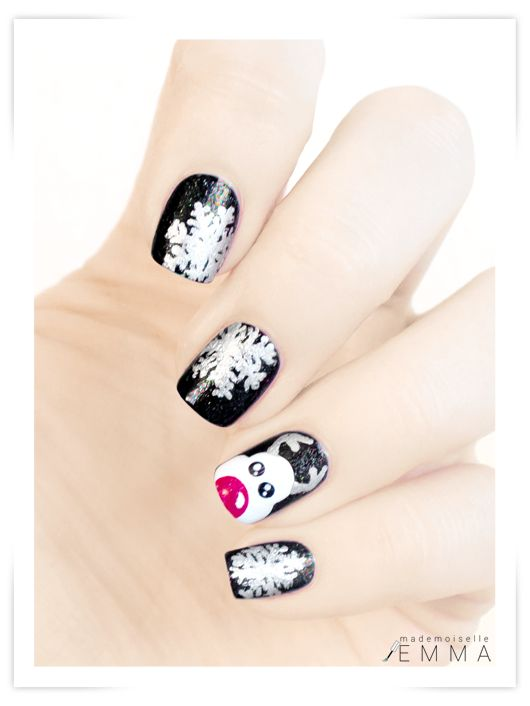 Black Christmas nail design. I like this, it's not your traditional red & green.