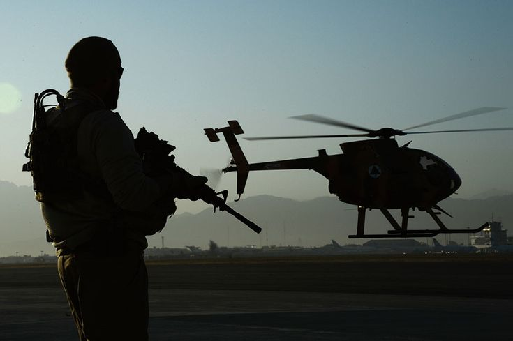U.S. Army Train, Advise, Assist Command–Air personal security detail shift lead provides security while MD-530 Cayuse Warrior takes off with all-Afghan crew for combat mission, September 27, 2015 (U.S. Air Force/Sandra Welch)