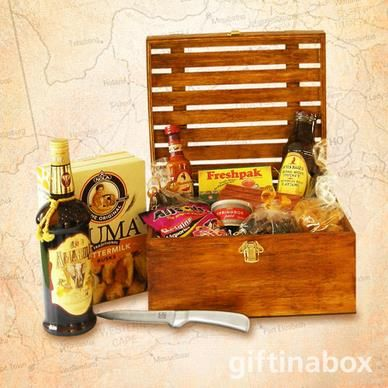 PROUDLY SOUTH AFRICAN Our good old South African favourites for the true spirited patriot.Try out this gourmet gift hamper. All treats are lovingly presented in an exquisite wooden crate with hinged lid and filled with wood wool.   100g Dried wors 375ml Bottle of Amarula cream liquor 80g Kudu wors 80g Beef biltong Springbok pate tin Ouma rusks Koeksisters Rooibos tea Chutney Hot peri peri sauce Guava fruit rolls Liquorice all sorts Stainless steel biltong knife